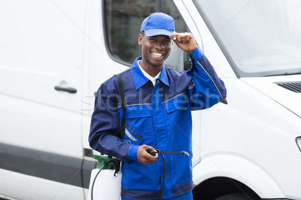Young Smiling Male Worker With Pesticide Sprayer Stock photo © AndreyPopov