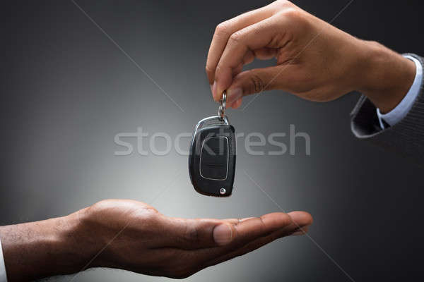 Hand Passing Car's Key To New Owner Stock photo © AndreyPopov