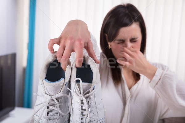 Nő tart koszos cipők kéz fiatal Stock fotó © AndreyPopov