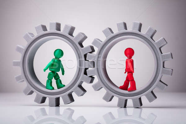 Two Human Figures Walking In Interlocked Gears Stock photo © AndreyPopov