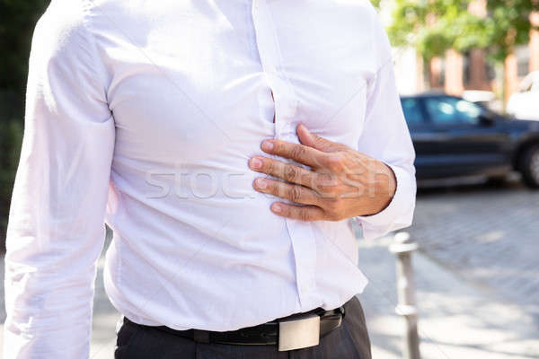 Man Suffering From Abdominal Pain Stock photo © AndreyPopov