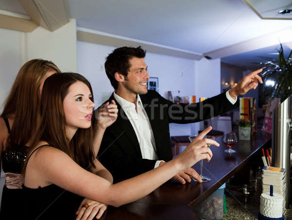 Ordering drinks at the bar Stock photo © AndreyPopov
