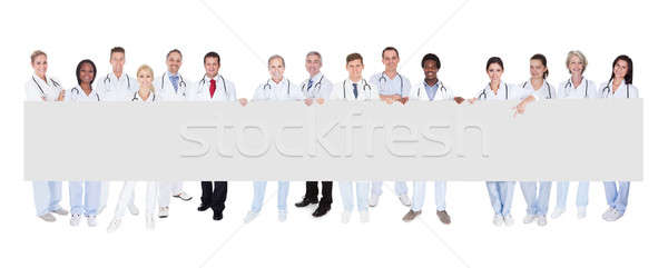 Group Of Doctors With Placard Stock photo © AndreyPopov