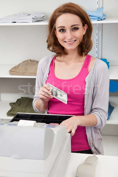 Young Female Cashier With Cash Register Stock photo © AndreyPopov