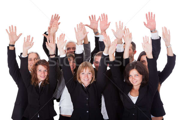 Group of business people waving in acknowledgment Stock photo © AndreyPopov