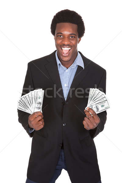 Excited Businessman Holding Dollar Currency Stock photo © AndreyPopov