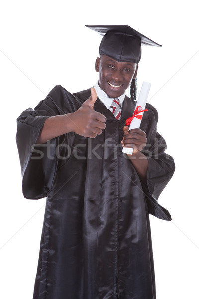Young Graduation Man Holding Diploma Stock photo © AndreyPopov