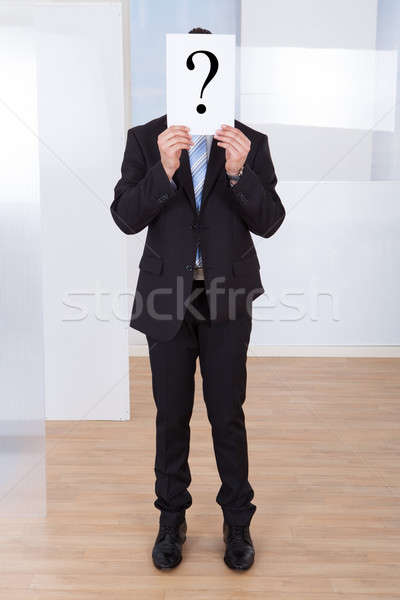 Businessman Holding Paper With Question Mark Stock photo © AndreyPopov