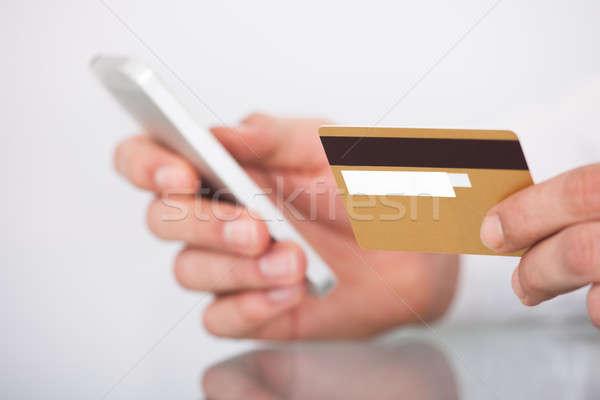 Foto stock: Homem · compras · cartão · de · crédito · telefone · móvel · imagem · internet