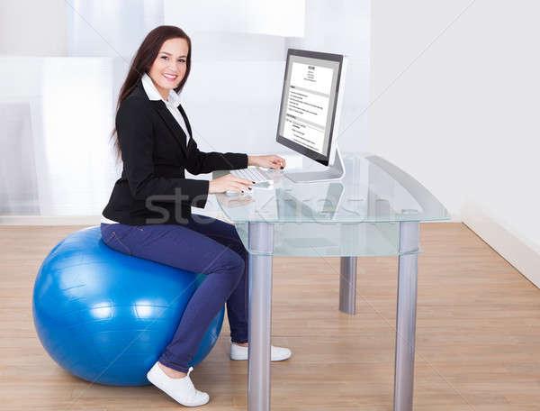 деловая женщина сидят пилатес мяча вид сбоку Сток-фото © AndreyPopov