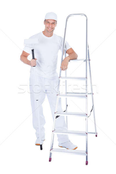 Painter With Paint Roller And Ladder Stock photo © AndreyPopov