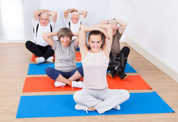 Trainer And Senior Customers Stretching At Gym Stock photo © AndreyPopov
