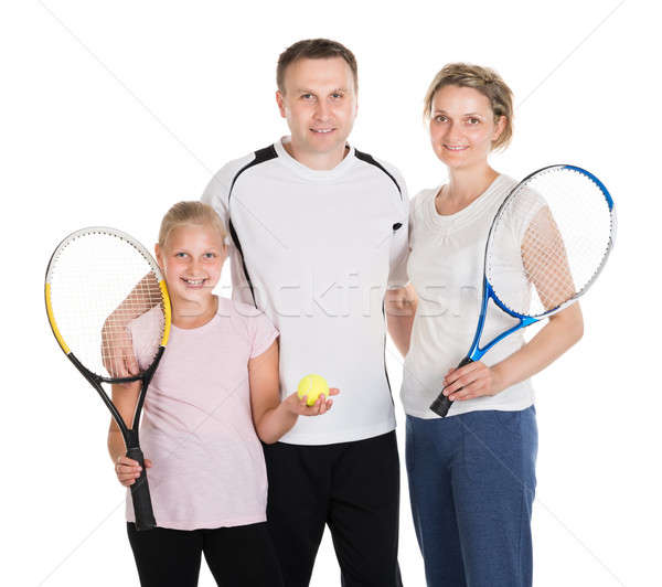 Young Family With Tennis Racquets Stock photo © AndreyPopov