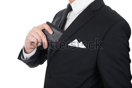 Businessman Putting Wallet In His Pocket Stock photo © AndreyPopov