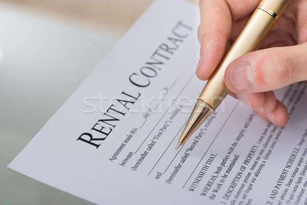 Hand Filling Rental Contract Form Stock photo © AndreyPopov