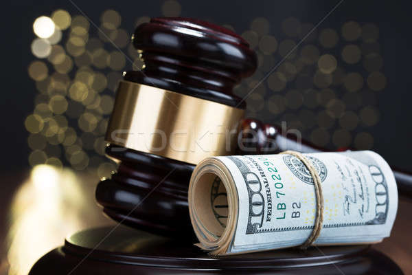 Gavel With Rolled Banknote Stock photo © AndreyPopov