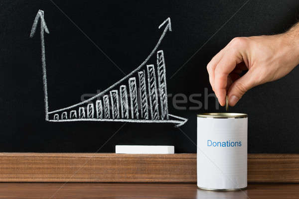 Close-up Of A Person Giving Donation Stock photo © AndreyPopov