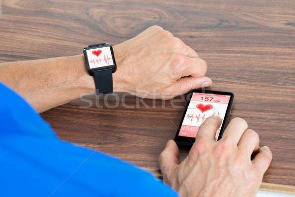 Male Hand With Smartwatch And Cellphone Stock photo © AndreyPopov