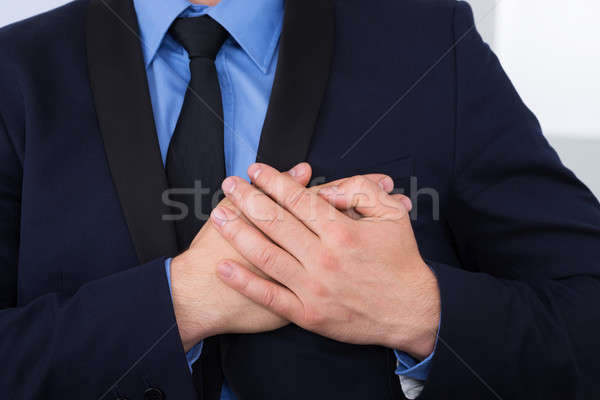 Businessman With Hand On Chest Stock photo © AndreyPopov