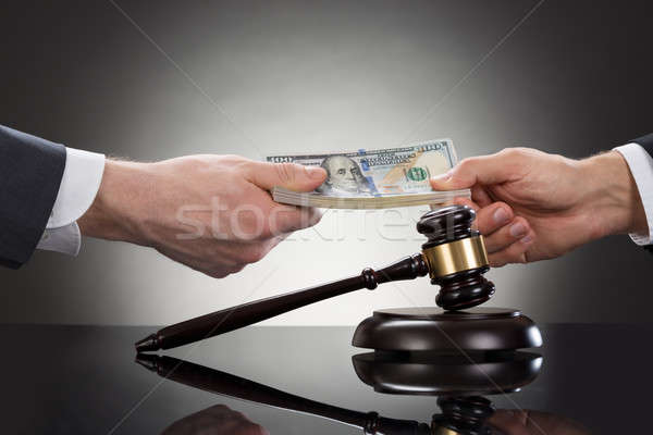 Businessman Taking Bribe In Front Of Mallet Stock photo © AndreyPopov