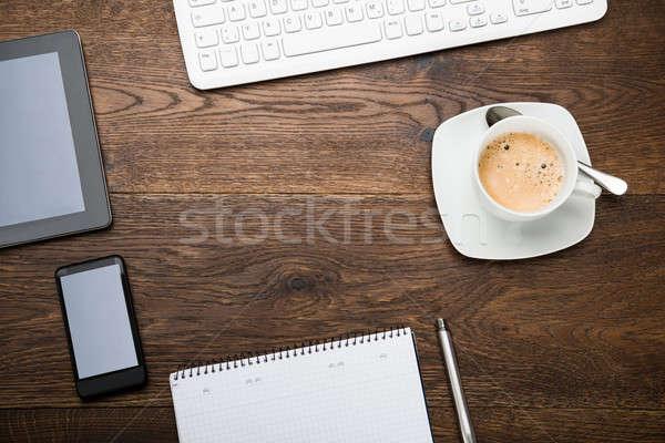 Telefonu komórkowego dziennik kubek herbaty Zdjęcia stock © AndreyPopov