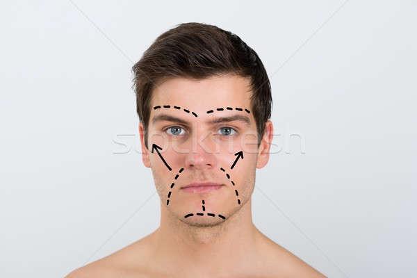 человека лице перфорация линия молодым человеком Сток-фото © AndreyPopov