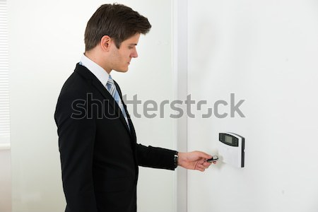 Businessman Using Door Security System Stock photo © AndreyPopov