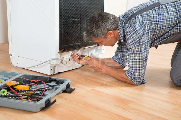 Repairman Repairing Dishwasher With Screwdriver Stock photo © AndreyPopov