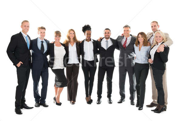 Confident Business Team Standing With Arms Around Stock photo © AndreyPopov