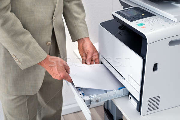 Businessman Using Printer In Office Stock photo © AndreyPopov