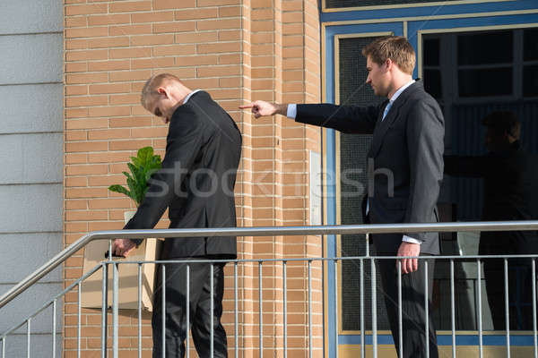 Businessman Firing Employee Outside Office Stock photo © AndreyPopov