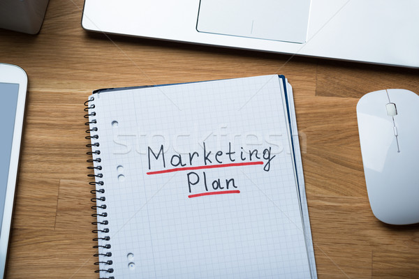 Marketing Plan Written On Notepad At Office Desk Stock photo © AndreyPopov