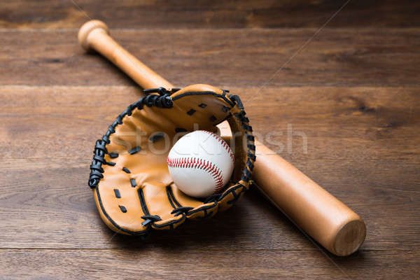 Baseball Glove And Ball With Bat On Table Stock photo © AndreyPopov