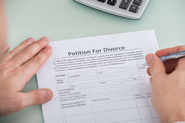 Person Hand Over Petition For Divorce Form Stock photo © AndreyPopov