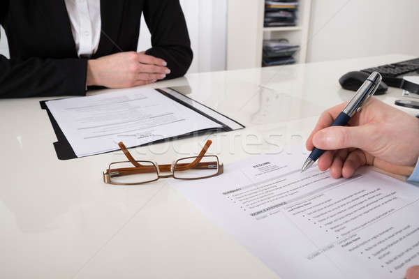 Businessperson With Resume And Pen Stock photo © AndreyPopov