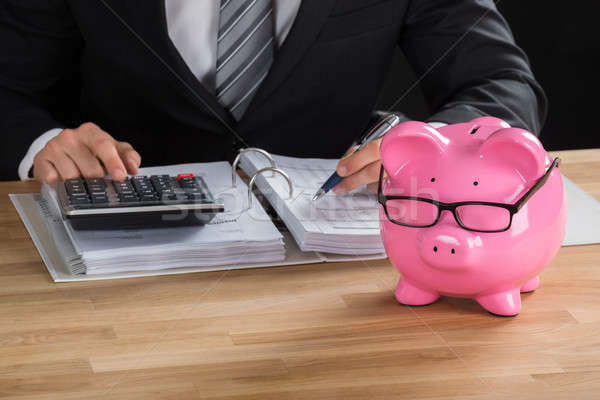 Male Accountant Calculating Tax At Desk Stock photo © AndreyPopov