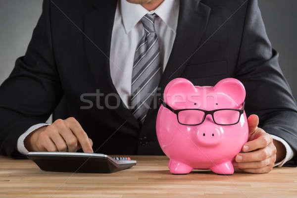 Businessman Using Calculator To Calculate Stock photo © AndreyPopov