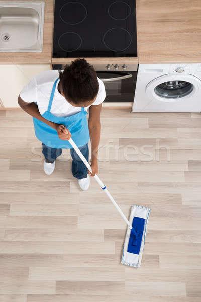 Női gondnok takarítás padló konyha magasról fotózva Stock fotó © AndreyPopov
