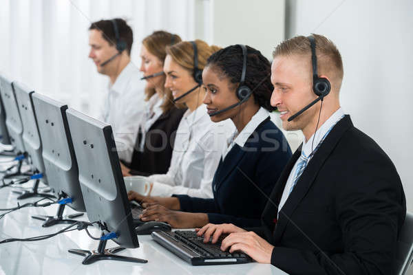 Businesspeople Working In Call Center Stock photo © AndreyPopov