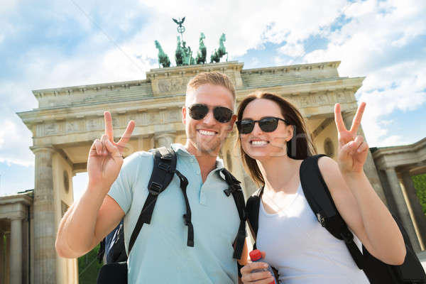 Stock photo: Happy Couple Making Peace Sign