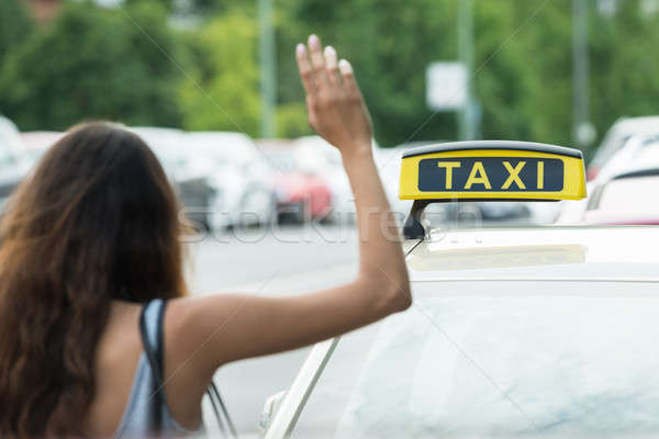 Woman Calling For Taxi Stock photo © AndreyPopov