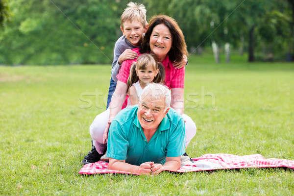 Retrato feliz avô netos parque avós Foto stock © AndreyPopov