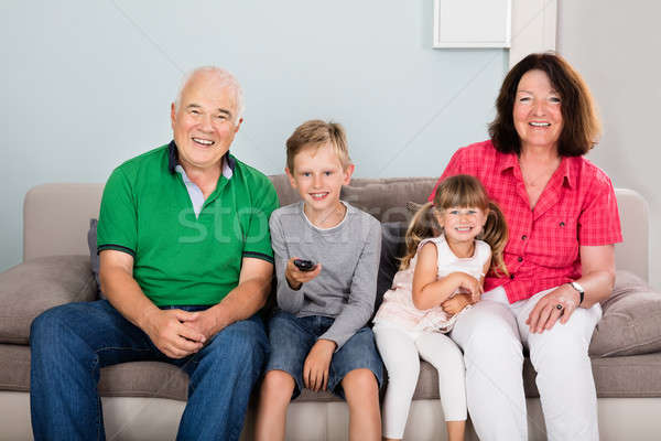 Grandparent And Grandchildren Watching Television Together Stock photo © AndreyPopov