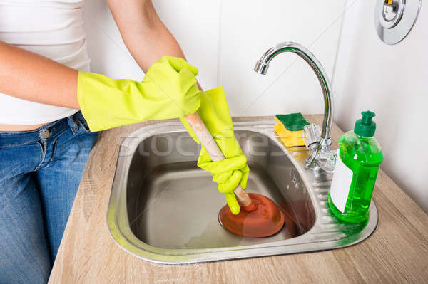 Person Using Plunger In The Sink Stock photo © AndreyPopov