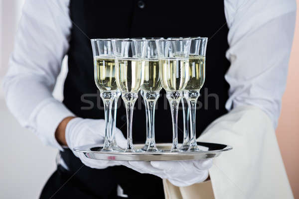 Man Holding Champagne Glasses Stock photo © AndreyPopov