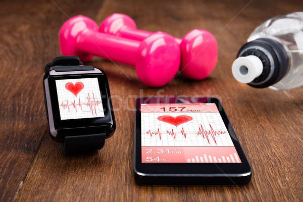 Mobile Phone With Smart Watch And Gym Equipment Stock photo © AndreyPopov