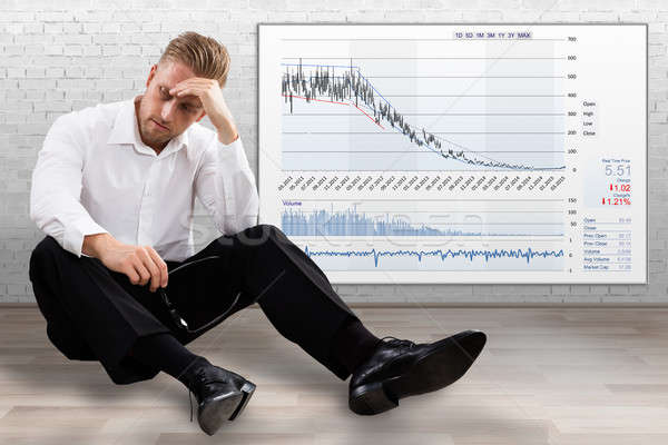 Upset Businessman With Deflation Graph Stock photo © AndreyPopov