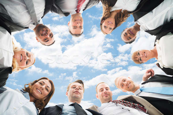 Businesspeople Forming Huddle Stock photo © AndreyPopov