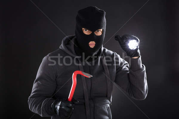 Portrait Of A Burglar On Black Background Stock photo © AndreyPopov