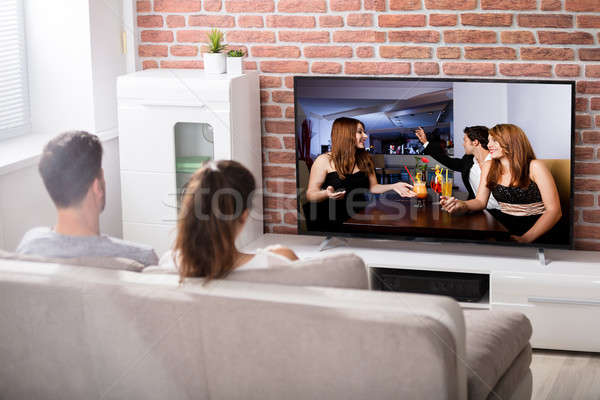 Couple Watching Television Stock photo © AndreyPopov